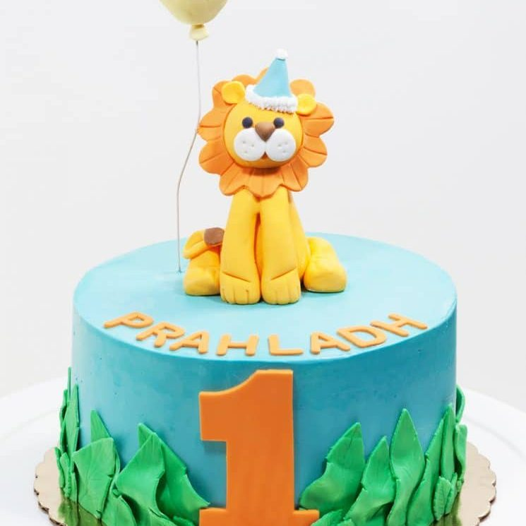 Lion first birthday cake from Whipped Bakeshop